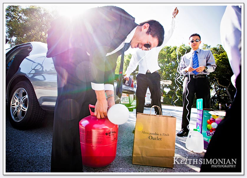 Members of the bridal party inflate balloons for the wedding ceremony at Pulgas Water temple