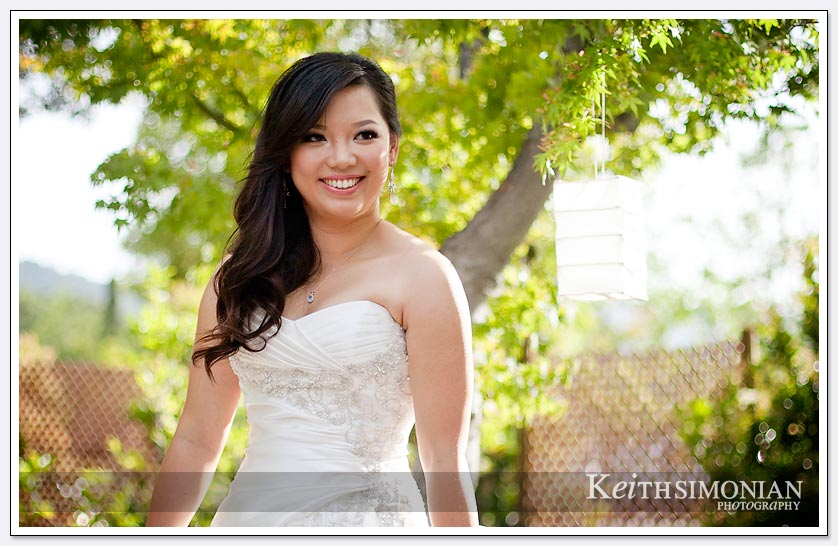 The beautiful trees outside the Saratoga Foothill Club make serve as a backdrop for a bridal portrait
