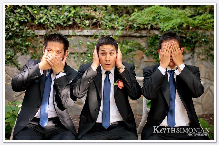 The groomsmen act the scene hear no evil, see no evil, speak no evil