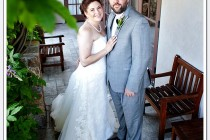 Bride and groom pose for photo after first look