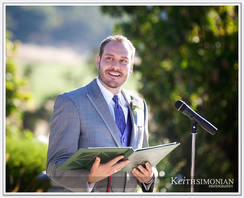 Best man reading during the wedding ceremony