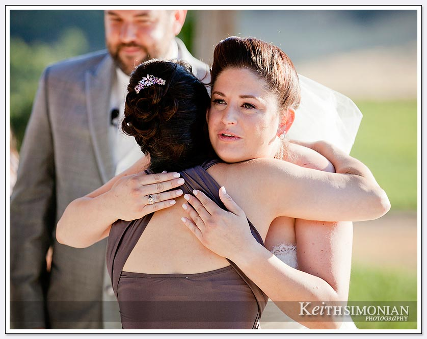 Hugs during the wedding ceremony at the Clos La Chance winery