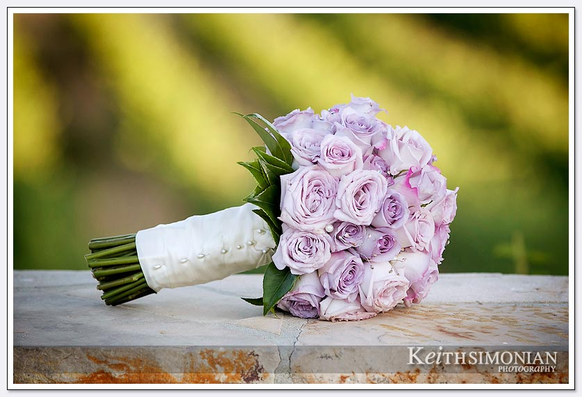 The winery of the Clos La Chance provides a backdrop for the Bride's bouquet