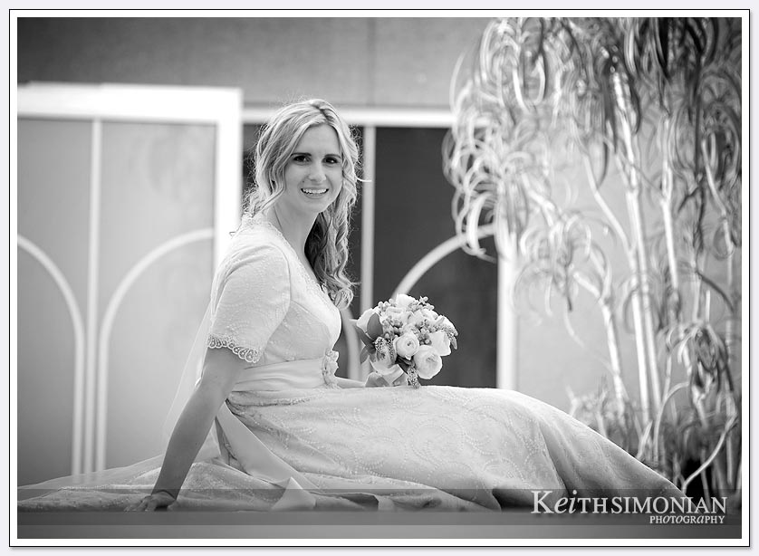 Black and white photo of Bride posing with her bouquet