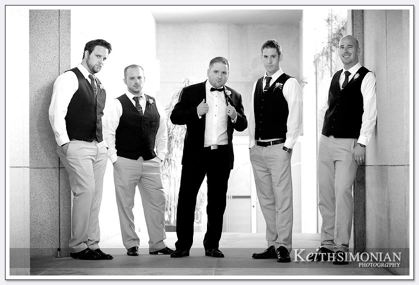 Black and white photograph of groom with groomsmen