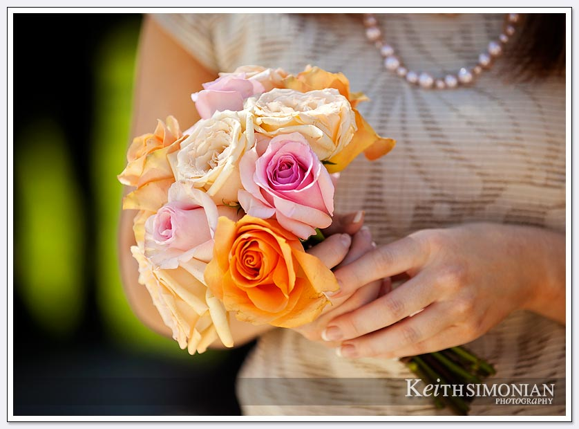 Bridesmaid bouquet with yellow, orange, and white flowers