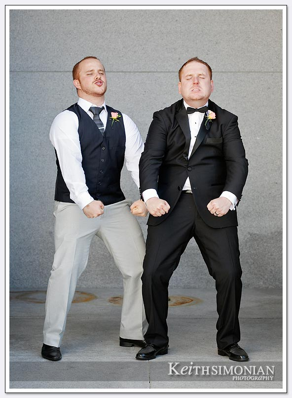The groom and one of his groomsmen ham it up for the photographer