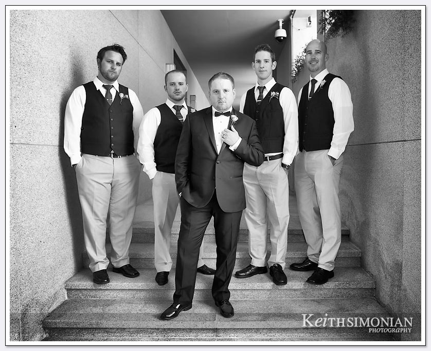 Black and white photo of groom with his groomsmen