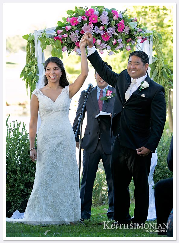 The bride and groom celebrate as husband and wife at The Lakes at El Segundo