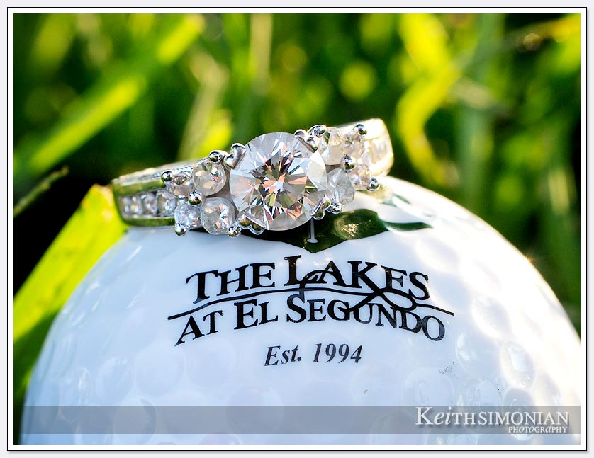 The brides engagement ring sits atop a golf ball from The Lakes at El Segundo golf course