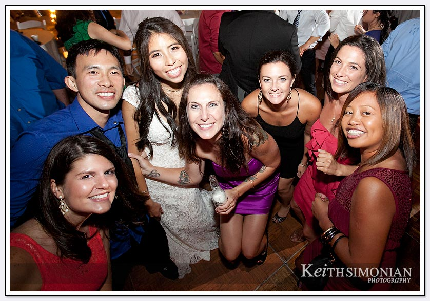 The bride and her friends pose for a photo on the dance floor at The Lakes at El Segundo