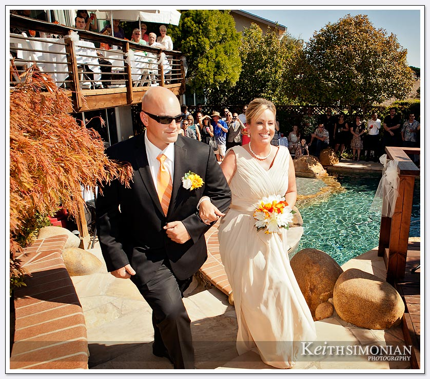 With a backyard wedding you can have great views with family and friends poolside to enjoy the ceremony.