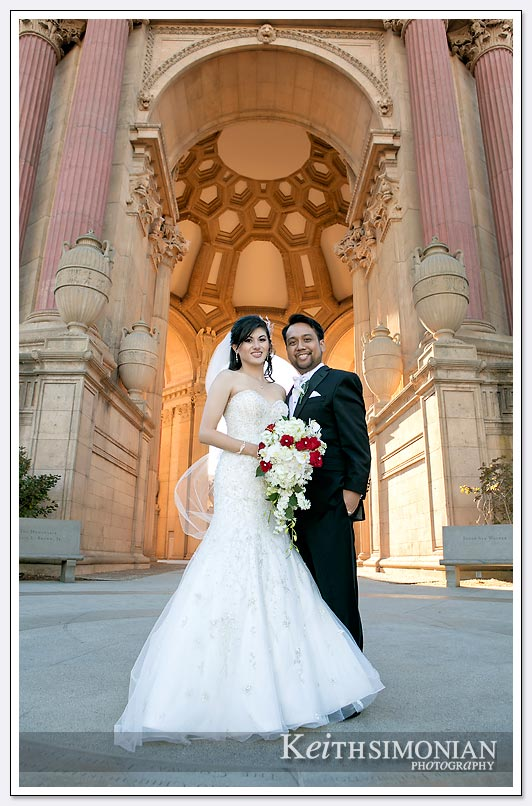 The dome of the Palace of Fine Arts in San Francisco serves as the backdrop for the Bride and Groom