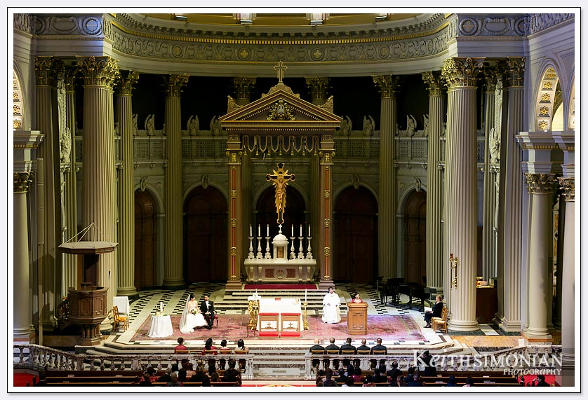 The wedding ceremony at St. Ignatius church in San Francisco viewed from the balcony.