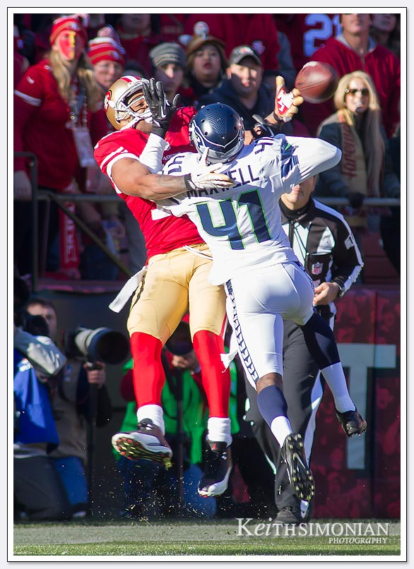 SAN FRANCISCO, CA - DECEMBER 08: Michael Crabtree #15 of the San Francisco 49ers is mugged by Bryon Maxwell #41 of the Seattle Seahawks while defending this pass during the second quarter at Candlestick Park on December 8, 2013