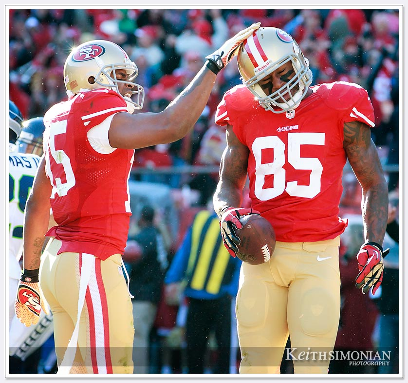 Dec 8, 2013; San Francisco, CA:  San Francisco 49ers tight end Vernon Davis (#85) is patted on the helmut by Michael Crabtree #15 after catching a touchdown pass against the Seattle Seahawks in the second quarter at Candlestick Park.