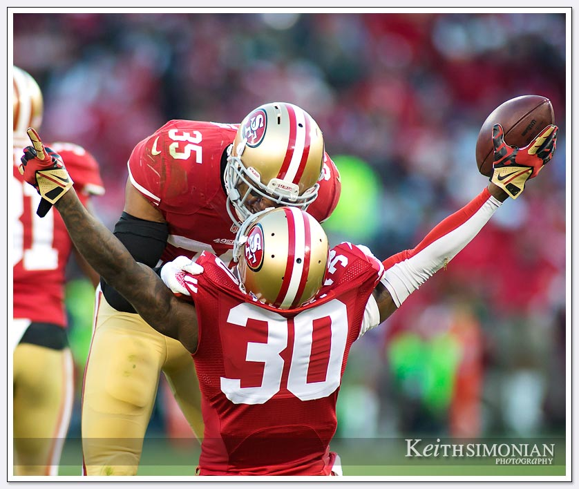 San Francisco 49er Eric Reid celebrates with Eric Wright over his game ending interception against the Seattle Seahawks on December 8, 2013 at Candlesick Park