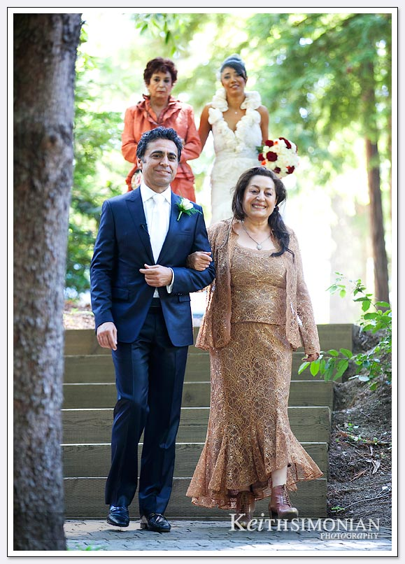 Bride and groom enter the Amphitheater of the Redwoods at the same time during this Persian wedding ceremony at Pema Osel Ling