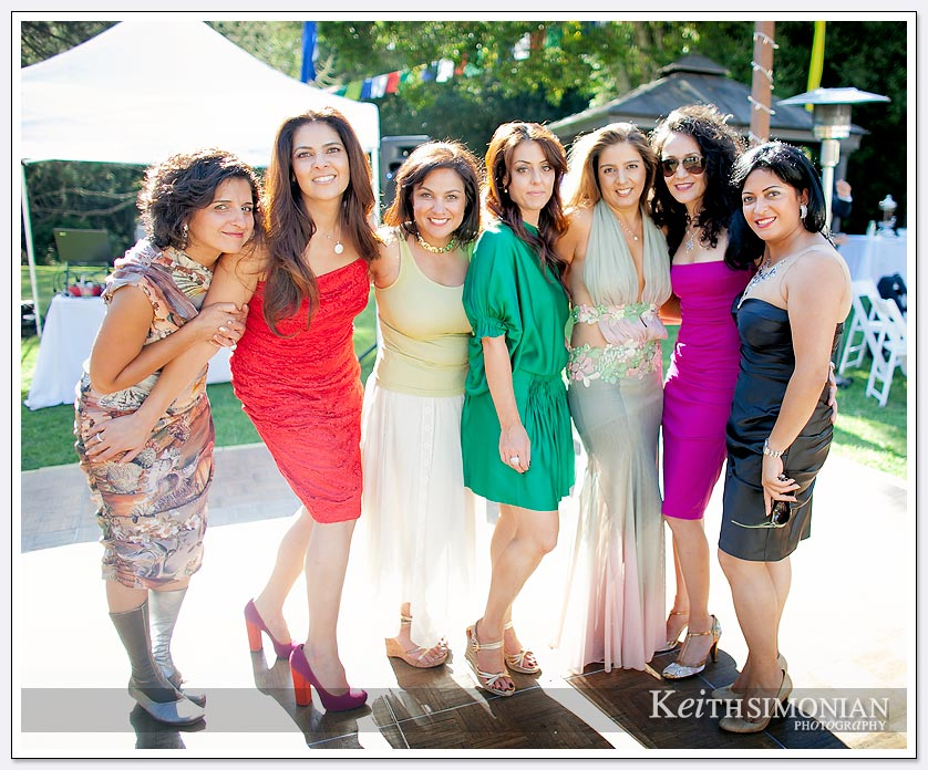 These wedding reception guests pose for a group photo at Pema Osel Ling