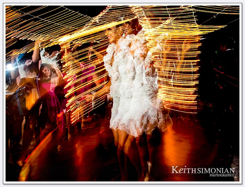 A nighttime wedding reception with the bride dancing at Pema Osel Ling.