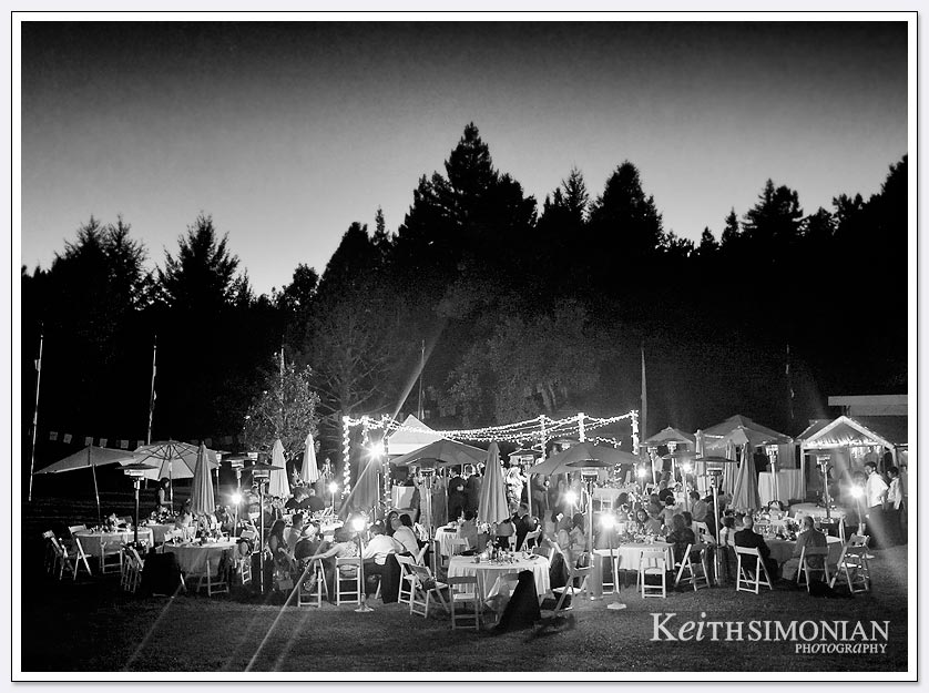 The lights twinkle during the nighttime outdoor reception at Pema Osel Ling