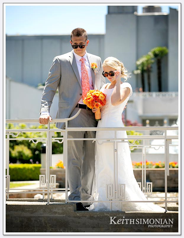 The bride and groom brought sunglasses just for photos outside the LDS Oakland temple