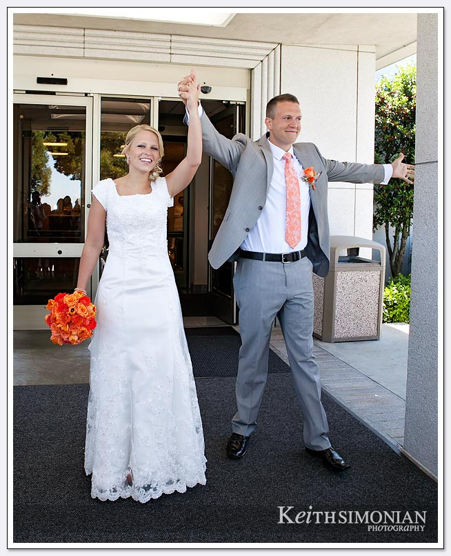 The bride and groom leave the Oakland LDS temple after just getting married