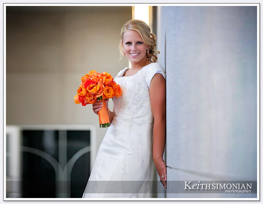 The bride poses with her bouquet outside the Oakland LDS temple