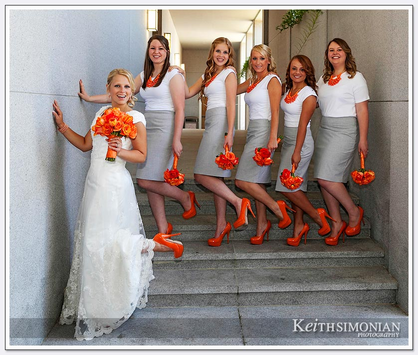The bride and bridesmaid pose for photo outside Oakland LDS temple