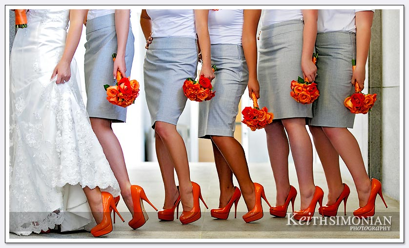 The bride and bridesmaids show off their orange high heel shoes outside the Oakland LDS temple