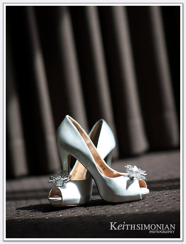 Interesting angle showing bride's shoes against curtain at the Le Meridien Hotel in San Francisco