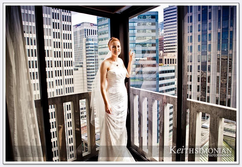 The many high rise buildings of San Francisco serve at backdrop for this bride getting ready in the Le Meridien Hotel