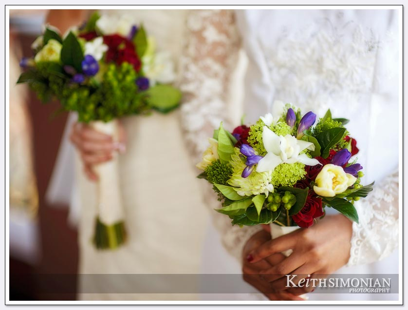 The bouquets are made up of red, yellow, purple and blue flowers