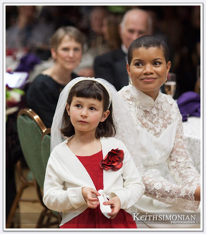 Bride and flower girl during reception in the Herbert Halper Town Hall room at the Delancey Street Foundation in San Francisco
