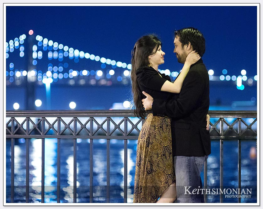 The lights glow from the Bay Bridge in the background - San-Francisco-Engagement-Photos
