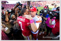 NFL football: #11 Alex Smith of the Kansas City Chiefs hugs Colin Kaepernick #7 of the San Francisco 49ers after the 49ers won their game at Levi's Stadium in Santa Clara, CA on October 5th, 2014.