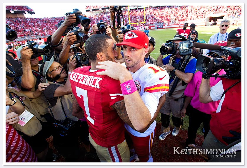 NFL football: #11 Alex Smith of the Kansas City Chiefs hugs  Colin Kaepernick #7 of the San Francisco 49ers after the 49ers won their game at Levi Stadium in Santa Clara, CA on October 5th, 2014.