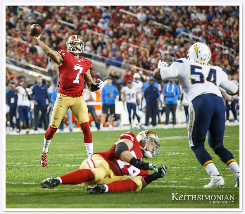 Canon-5D-Mark3-NFL-Game - San Francisco 49er quarterback Colin Kaepernick throws to the end zone against the San Diego Chargers in a rare Saturday night NFL game.