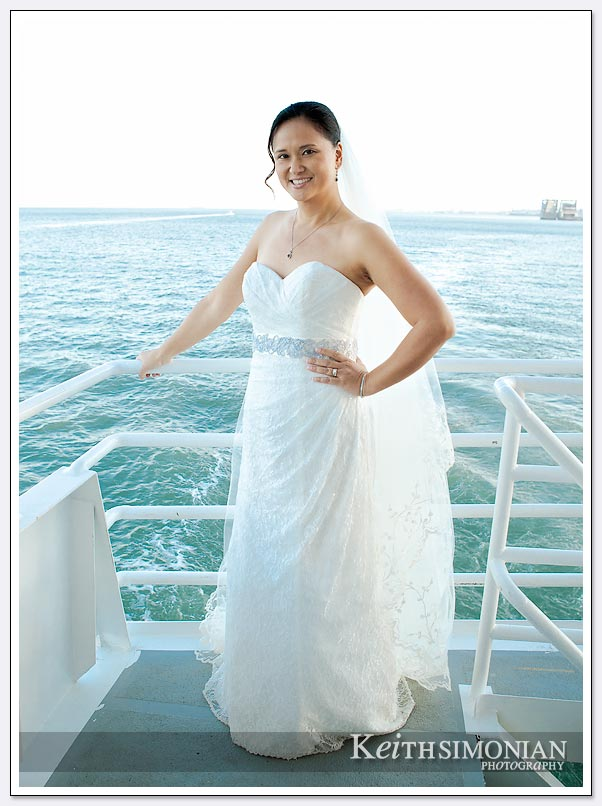Bride poses on the deck of Commodore Cruise line