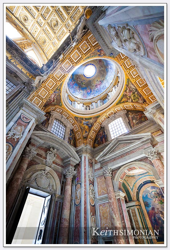 The light streaming through the dome highlights the beauty of the display on the ceiling - St. Peter's Basilica