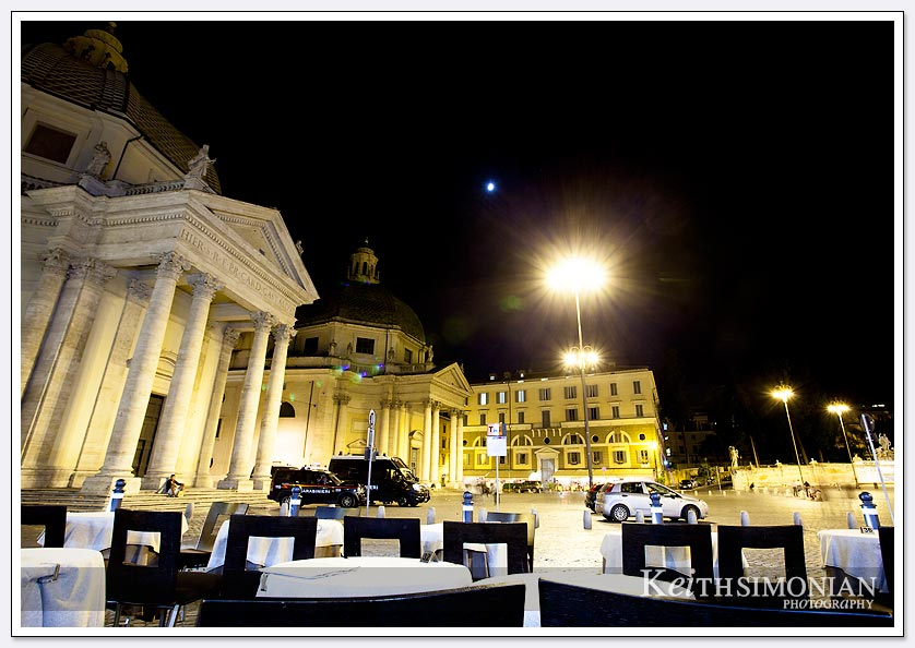 Outdoor cafe in the Piazza del Papolo with views of both Santa Maria dei Miracoli and Santa Maria in Montesanto churches