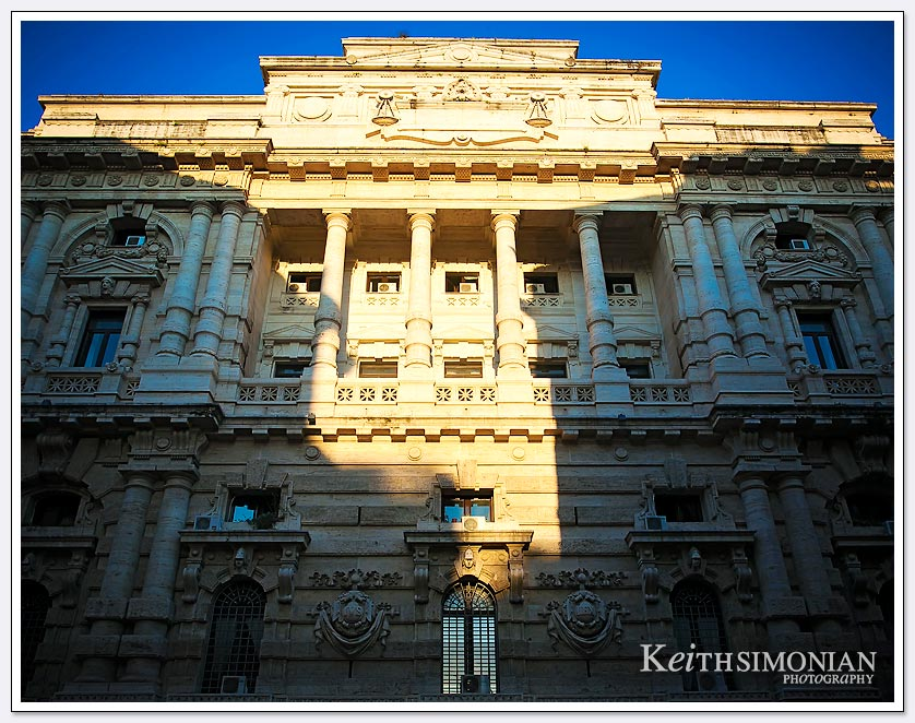 Morning sunlight shines through other buildings onto the Palace of Justice - Rome
