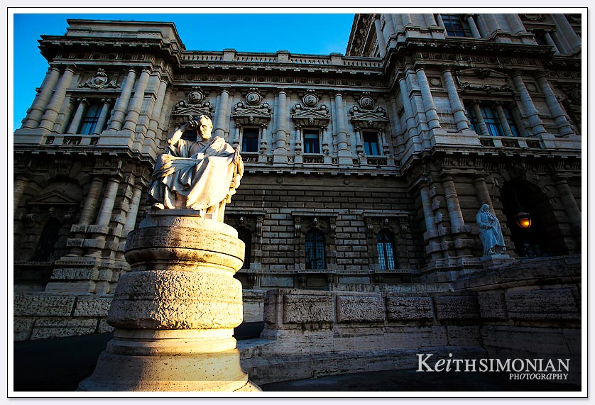 The early morning sunlight hits a statue outside the Palace of Justice in Rome Italy