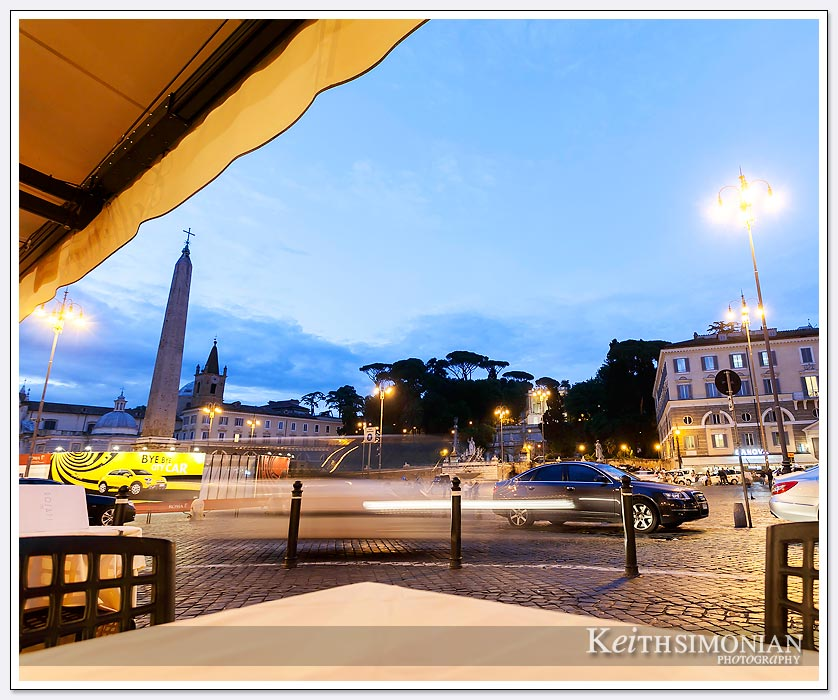 Night view from an outdoor cafe at the Piazza del Popolo