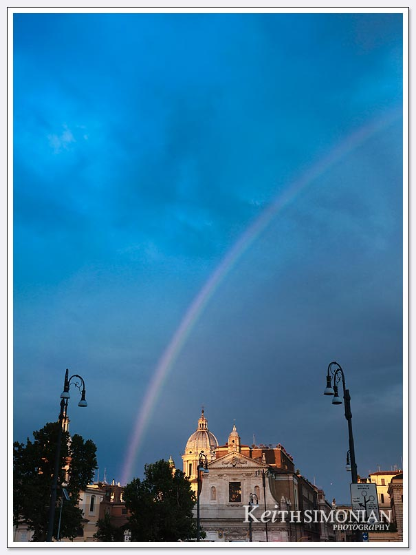 The light rain and sunlight created a rainbow over Rome Italy