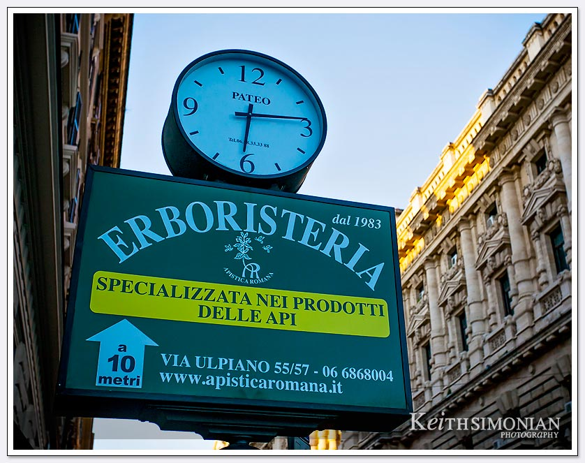 The Erboristeria clock says the time is 6:15 AM