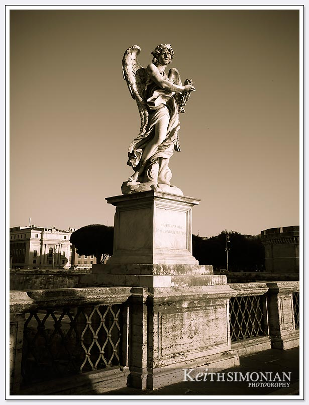 Statue on bridge over the fiume tevere.