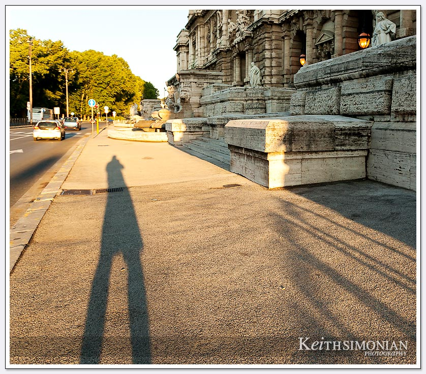Early morning shadow of tourist taking photos in Rome Italy
