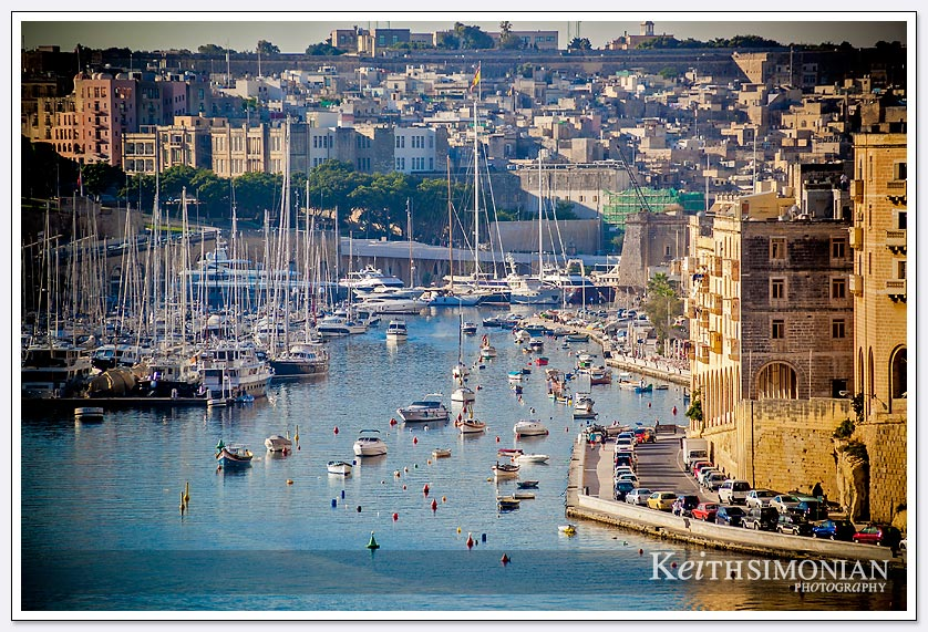 The early morning light hits the many boats in the port of Valletta, Malta