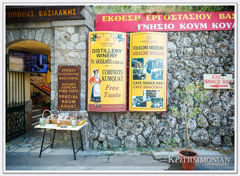 The sign on the wall offers a free taste of Corfiots Kumquat - Corfu, Greece